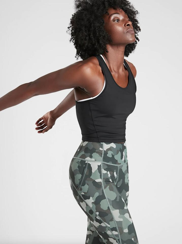 """<p>Allyson also wore the <a href=""""https://www.popsugar.com/buy/Black-Lightning-Crop-Tank-SuperSonic-481818?p_name=Black%20Lightning%20Crop%20Tank%20in%20SuperSonic&retailer=athleta.gap.com&pid=481818&price=59&evar1=fit%3Aus&evar9=46515938&evar98=https%3A%2F%2Fwww.popsugar.com%2Fphoto-gallery%2F46515938%2Fimage%2F46515953%2FBlack-Lightning-Crop-Tank-in-SuperSonic&prop13=api&pdata=1"""" rel=""""nofollow"""" data-shoppable-link=""""1"""" target=""""_blank"""" class=""""ga-track"""" data-ga-category=""""Related"""" data-ga-label=""""http://athleta.gap.com/browse/product.do?pid=486325#pdp-page-content"""" data-ga-action=""""In-Line Links"""">Black Lightning Crop Tank in SuperSonic</a> ($59) to compete at the USATF Outdoor Championships.</p>"""