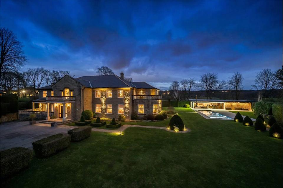 """<p>This house in West Yorkshire is a real head-turner. Boasting six sprawling bedrooms, a <a href=""""https://www.housebeautiful.com/uk/garden/a36591989/outdoor-cinema-ideas/"""" rel=""""nofollow noopener"""" target=""""_blank"""" data-ylk=""""slk:cinema"""" class=""""link rapid-noclick-resp"""">cinema</a>, games room and a home automation system with CCTV, it's a complete dream. Tempted? You'll need £2.3 million to make this home your own...</p><p>This property is currently on the market for £2,375,000 with Fine & Country via <a href=""""https://www.zoopla.co.uk/for-sale/details/57921106/"""" rel=""""nofollow noopener"""" target=""""_blank"""" data-ylk=""""slk:Zoopla"""" class=""""link rapid-noclick-resp"""">Zoopla</a>.</p>"""