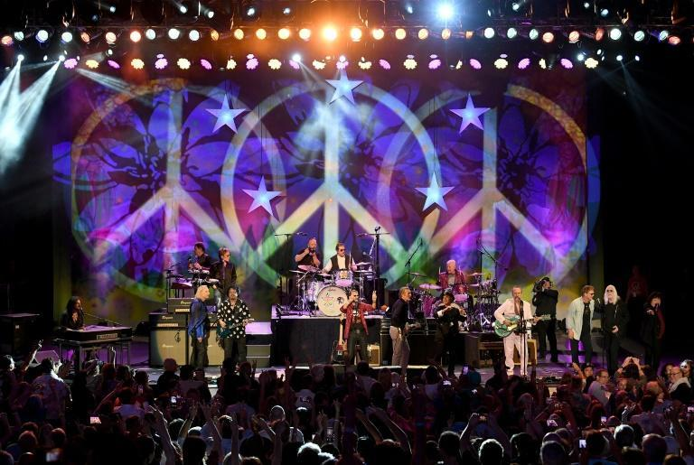 Ringo Starr (center) performing with Joe Walsh, Nils Lofgren, Steve Lukather, Gregg Rollie, Colin Hay, Warren Hamm, Gregg Bissonette, Hamish Stuart and Edgar Winter during an All Starr Band concert at The Greek Theatre in 2019 in Los Angeles