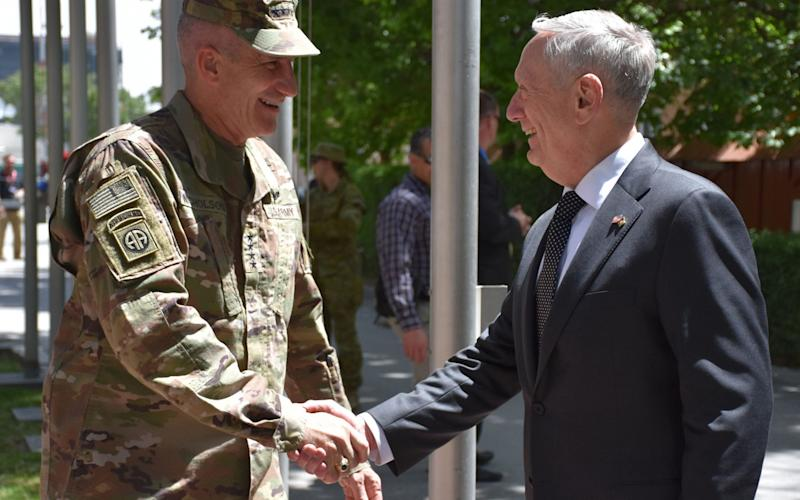 This handout photograph released by NATO's Resolute Support Mission in Afghanistan on April 24, 2017 shows US Secretary of Defense James Mattis arriving at Resolute Support headquarters in Kabul to meet with US Army General John Nicholson (L), commander of US forces in Afghanistan - Credit: AFP
