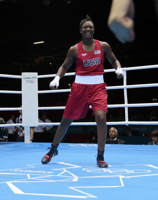 In this Thursday, Aug. 9, 2012 photo, the United States' Claressa Shields, celebrates winning against Russia's Nadezda Torlopova, in their women's middleweight 75-kg boxing gold medal match at the 2012 Summer Olympics, in London. (AP Photo/Ivan Sekretarev)