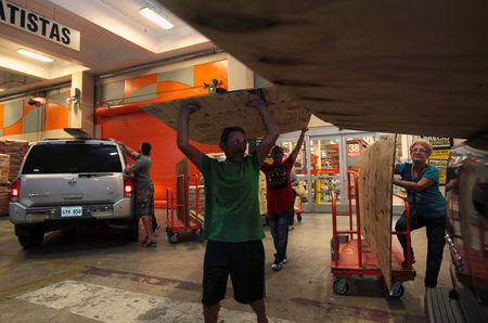 People buy materials at a hardware store after Puerto Rico Governor Ricardo Rossello declared a state of emergency in preparation for Hurricane Irma in Bayamon