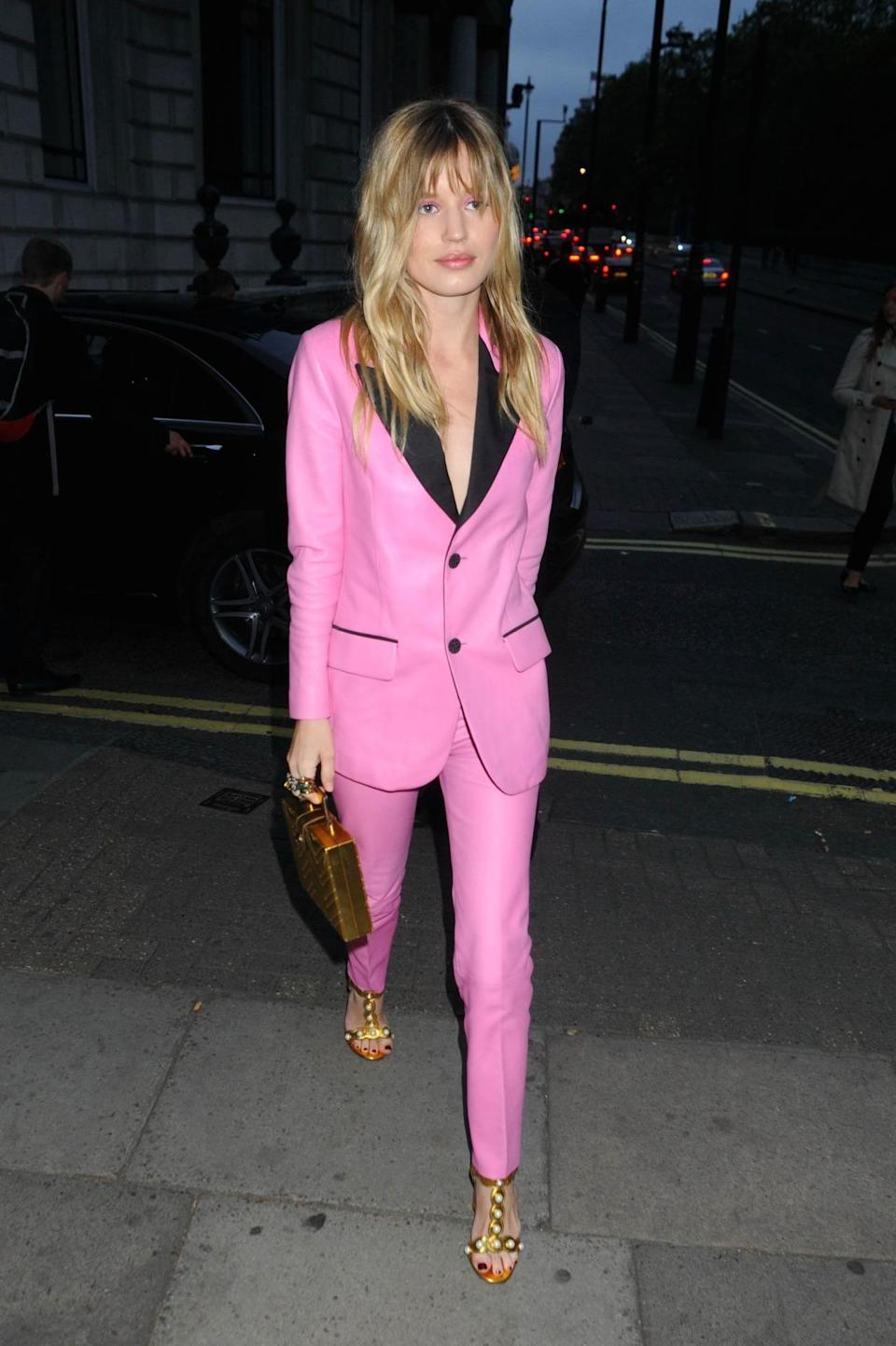<p>Georgia looked super hot in this hot pink suit. The gold accessories finished it off perfectly, Elle Woods would be proud. <i>[Photo: Rex Features]</i></p>