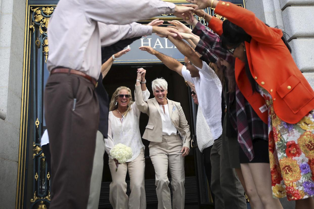 Newlyweds Stacy Wood, left, and Michele Barr leave San Francisco City Hall after getting married on June 26, 2015 — the day the Supreme Court ruled 5-4 that the Constitution guarantees marriage equality. A new Gallup poll shows more U.S. support of same-sex marriage than ever. (Photo: Reuters/Elijah Nouvelage)