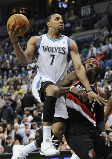 Minnesota Timberwolves' Derrick Williams (7) runs into Portland Trail Blazers' Gerald Wallace in the first half of an NBA basketball game Wednesday, March 7, 2012, in Minneapolis. (AP Photo/Jim Mone)