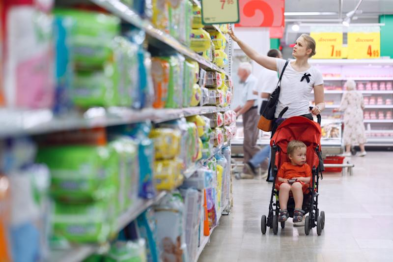 A mother shops with her child.