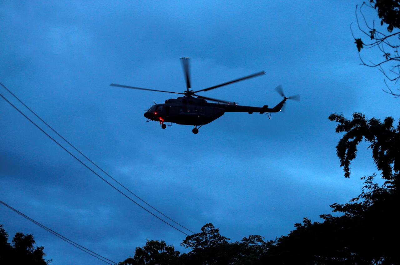 <p>A military helicopter believed to be carrying rescued schoolboys takes off near the Tham Luang cave complex in the northern Thailand on Sunday (8 July) evening. (PHOTO: Reuters) </p>
