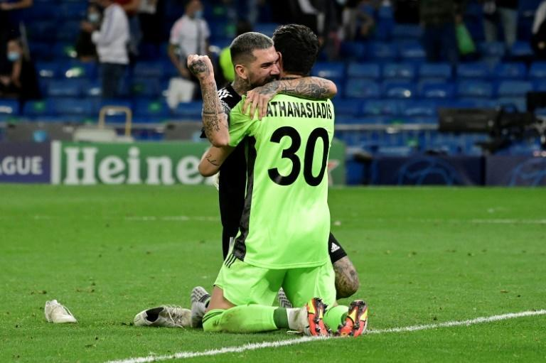 Sheriff's Dimitrios Kolovos and goalkeeper Giorgos Athanasiadis celebrate after beating Real Madrid in the Champions League on Tuesday. (AFP/JAVIER SORIANO)