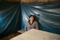 Maria Doralisa Medina, the mother of Luceli Banda Medina who is a former student of Peru's presidential candidate Pedro Castillo, poses for a photograph at home, in Puna