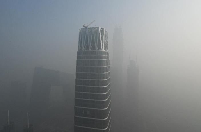 Firms are struggling to recruit - and retain - people with the expertise they need in highly polluted Asian cities like Beijing (AFP Photo/GREG BAKER)