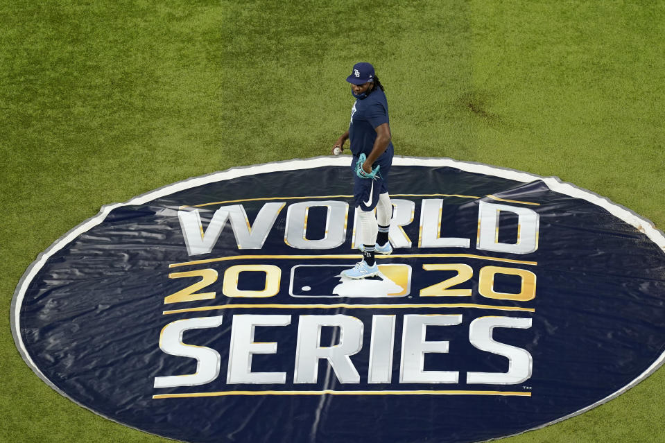Tampa Bay Rays relief pitcher Diego Castillo (63) stands on the pitcher's mound at Globe Life Field as the team prepares for the baseball World Series against the Los Angeles Dodgers, in Arlington, Texas, Monday day, Oct. 19, 2020, 2020. (AP Photo/Eric Gay)