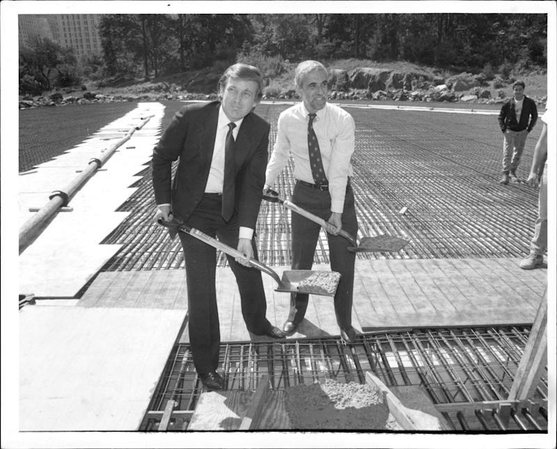 Donald Trump and Henry Stern lay the first cement at Wollman Rink in New York City's Central Park on Sept. 10, 1986.
