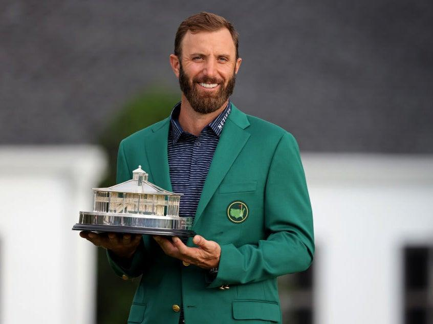 <p>Dustin Johnson poses with the trophy at August in 2020</p> (Getty Images)