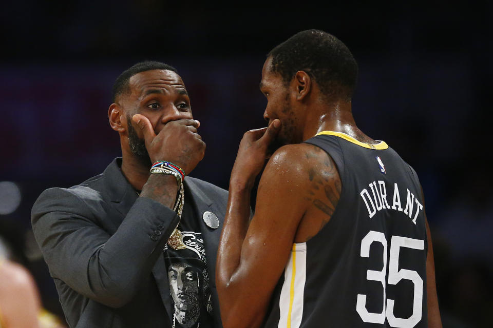 LeBron James and Kevin Durant will meet on Christmas for the first time since 2019. (Yong Teck Lim/Getty Images)