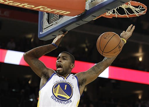 Golden State Warriors' Dorell Wright scores against the Miami Heat during the second half of an NBA basketball game Tuesday, Jan. 10, 2012, in Oakland, Calif. (AP Photo/Ben Margot)