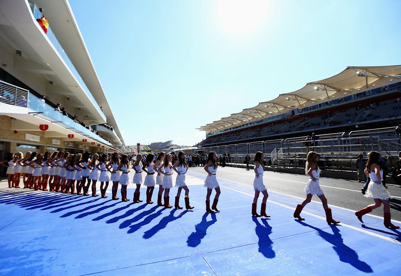 AUSTIN, TX - NOVEMBER 18:  Grid girls line up for the drivers parade before the United States Formula One Grand Prix at the Circuit of the Americas on November 18, 2012 in Austin, Texas.  (Photo by Paul Gilham/Getty Images)