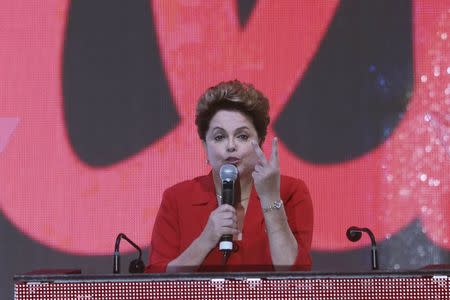 Brazil's President Dilma Rousseff gestures while speaking during the PT national convention in Brasilia