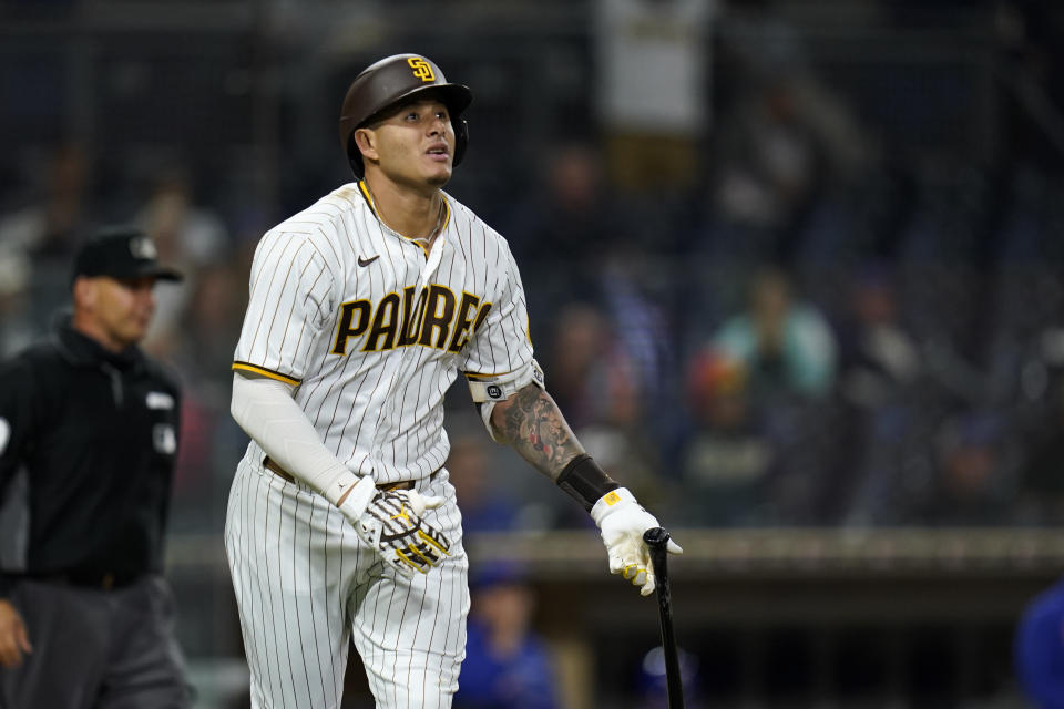 San Diego Padres' Manny Machado watches his home run hit during the eighth inning of a baseball game against the Chicago Cubs, Monday, June 7, 2021, in San Diego. (AP Photo/Gregory Bull)