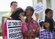 <p>Caitlin Sanger, left, is comforted outside the Supreme Court as Naomi Liem, 10, looks on at right, on Capitol Hill in Washington, Tuesday, June 26, 2018, as they protest immigrant families being split up. Both of their parents are being detained by Ice. Both are from Franklin Park, N.J. (Photo: Carolyn Kaster/AP) </p>