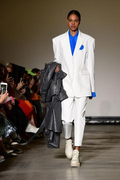 A white suit with prominent shoulders from Annakiki's Fall-Winter 2019-2020 collection. Milan, February 20, 2019