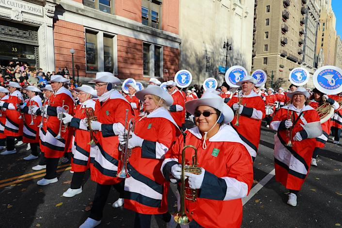 """The Awesome Second Time Arounders Marching Band from St. Petersburg, Fla. performs """"Enchano"""" in the 93rd Macy's Thanksgiving Day Parade in New York. This band is celebrating 38 years and its membership is open to anyone who has ever played, twirled or danced in a high school or college band and """"dreamed of doing it one more time."""" (Photo: Gordon Donovan/Yahoo News)"""