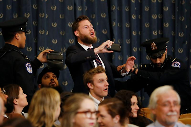 Owen Shroyer, an Infowars host, disrupts the beginning of a House Judiciary Committee impeachment hearing before being removed from police: AP