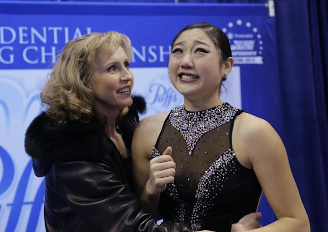 Mirai Nagasu, right, reacts to her scores as her coach Galina Barinova offers support during the women's free skate at the U.S. Figure Skating Championships Saturday, Jan. 11, 2014 in Boston. (AP Photo/Steven Senne)