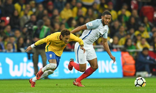 Joe Gomez tussles with Neymar in a friendly with Brazil that ended 0-0, with Gomez named man of the match on his first start for his country.