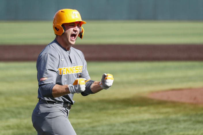 Tennessee outfielder Evan Russell (6) reacts to hitting a home run during an NCAA college baseball super regional game against LSU Sunday, June 13, 2021, in Knoxville, Tenn. Tennessee won 15-6 to advance. (AP Photo/Wade Payne)