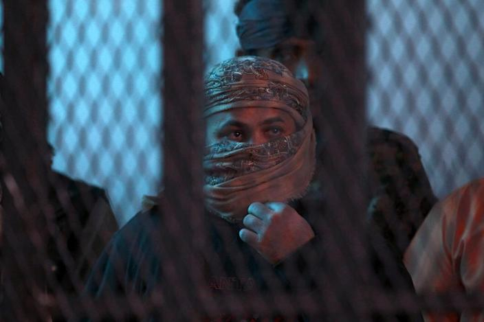 Suspected Al-Qaeda militants stand behind bars during a hearing at the appeals court in the Yemeni capital Sanaa on February 10, 2015 (AFP Photo/Mohammed Huwais)