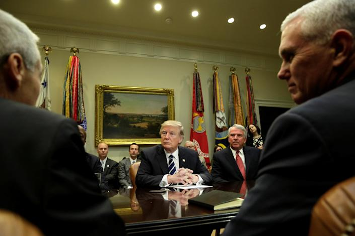 U.S. President Donald Trump (C) and Vice President Mike Pence (R) meet with Pharma industry representatives at the White House in Washington, U.S., January 31, 2017. REUTERS/Yuri Gripas TPX IMAGES OF THE DAY