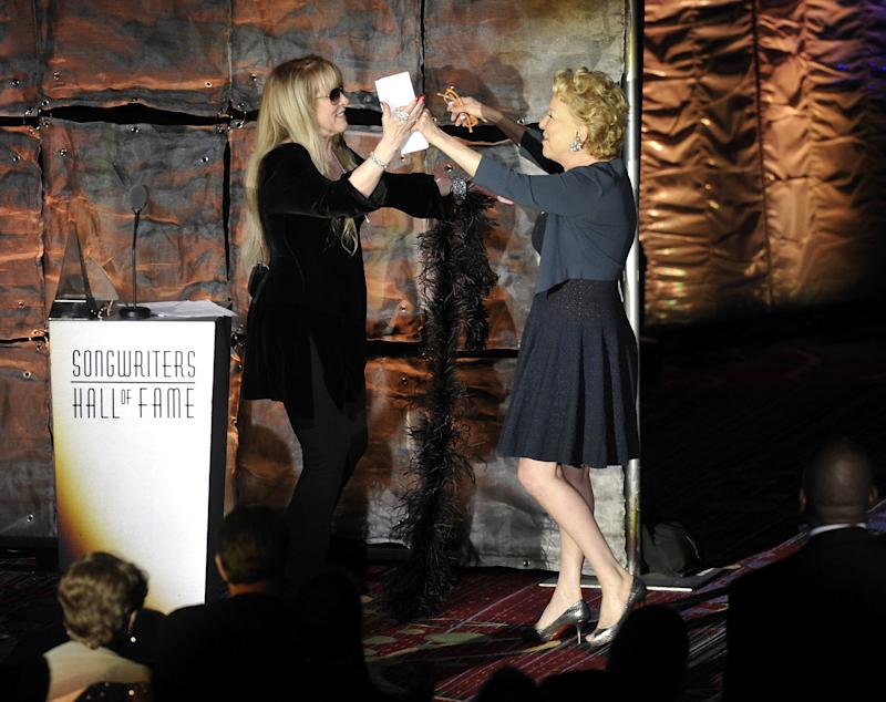Singer Stevie Nicks, left, introduces Lifetime Achievement Award recipient Bette Midler at the 2012 Songwriters Hall of Fame induction and awards gala at the Marriott Marquis Hotel, Thursday June 14, 2012 in New York. (Photo by Evan Agostini/Invision)