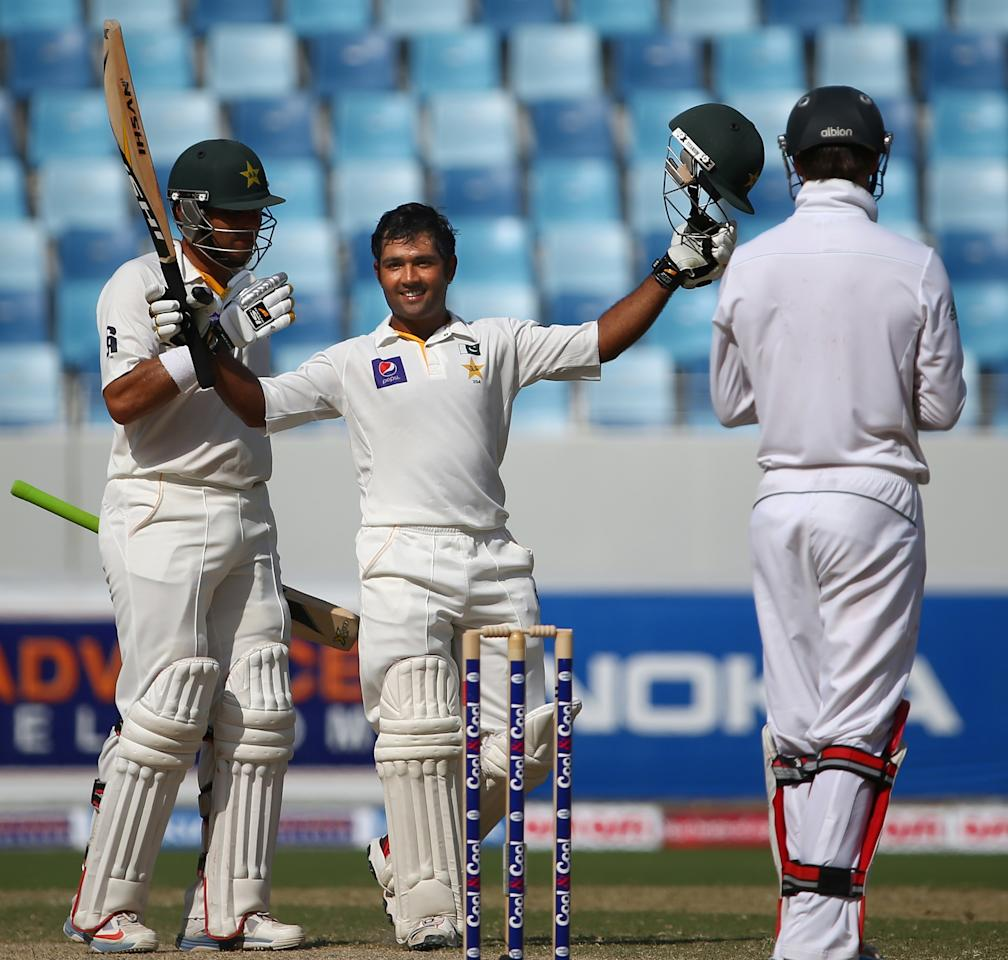 Batsman Asad Shafiq (C) of Pakistan celebrates after scoring a century during the fourth day of the second Test cricket match between Pakistan and South Africa in Dubai on October 26, 2013. AFP PHOTO/MARWAN NAAMANI        (Photo credit should read MARWAN NAAMANI/AFP/Getty Images)