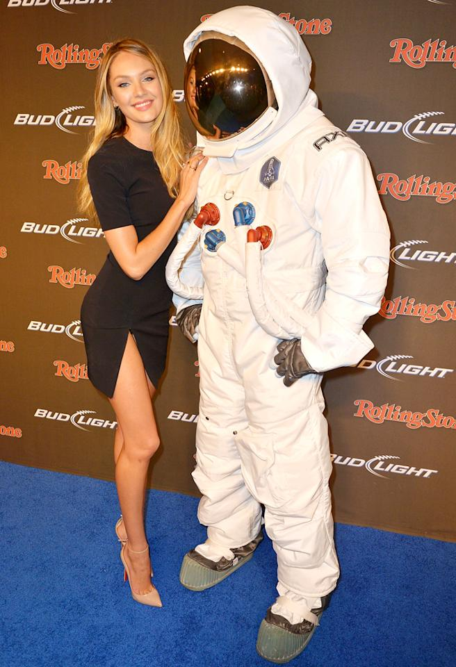 NEW ORLEANS, LA - FEBRUARY 01:  Model Candice Swanepoel poses with an AXE Astronaut at the Rolling Stone LIVE party held at the Bud Light Hotel on February 1, 2013 in New Orleans, Louisiana.  (Photo by Gustavo Caballero/Getty Images for Rolling Stone)