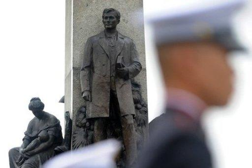 Members of a Philippine honour guard stand in formation in front of the Rizal Monument at Luneta Park in Manila on Sunday during a ceremony to mark the 150th birth anniversary of Philippine national hero Jose Rizal