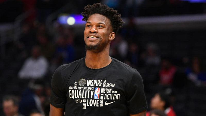 Jimmy Butler smiling on the basketball court