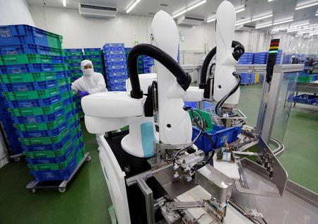 Kawasaki Heavy Industries' collaborative robot stacks rice balls at Delicious Cook &Co's food factory in Narashino, Japan, April 17, 2018.  REUTERS/Toru Hanai