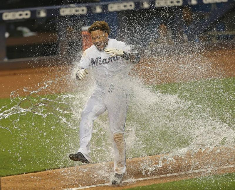 Miami Marlins left fielder Harold Ramirez (47) got dump with a cooler after hitting a solo walk-off home run during the twelve inning of a interleague Major League Baseball game at Marlins Park in Miami on Thursday, August 1, 2019. Marlins won 5-4.