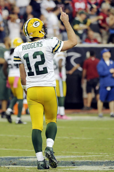Green Bay Packers quarterback Aaron Rodgers (12) celebrates a touchdown against the Houston Texans in the fourth quarter of an NFL football game, Sunday, Oct. 14, 2012, in Houston. (AP Photo/Dave Einsel)