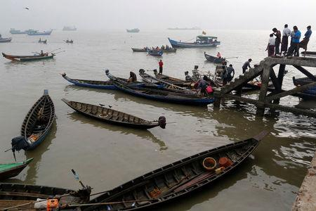 Rohingya fishermen are pictured at the port in Sittwe in the state of Rakhine, Myanmar March 3, 2017. Picture taken March 3, 2017.  REUTERS/Soe Zeya Tun