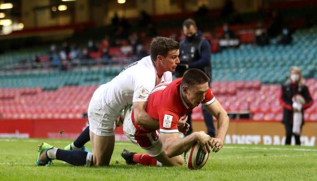 Wales' Josh Adams dives in to score the first try
