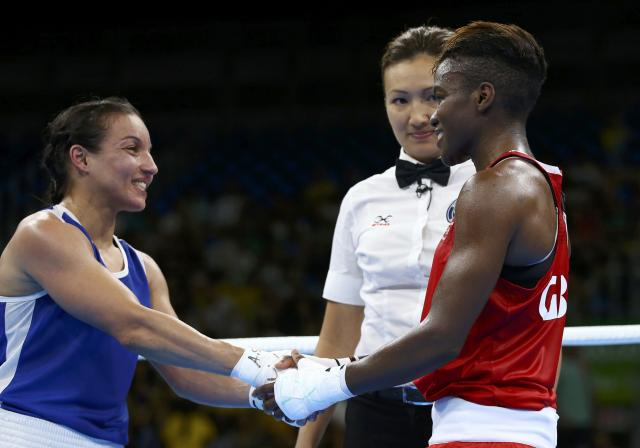 2016 Rio Olympics - Boxing - Final - Women's Fly (51kg) Final Bout 267 - Riocentro - Pavilion 6 - Rio de Janeiro, Brazil - 20/08/2016. Nicola Adams (GBR) of Britain and Sarah Ourahmoune (FRA) of France shake hands at the end of their bout. REUTERS/Peter Cziborra FOR EDITORIAL USE ONLY. NOT FOR SALE FOR MARKETING OR ADVERTISING CAMPAIGNS.