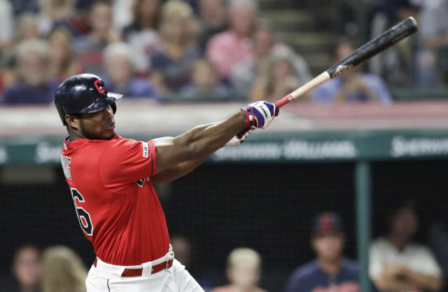 Cleveland Indians' Yasiel Puig hits a one-run double in the fourth inning in a baseball game against the Detroit Tigers, Thursday, Sept. 19, 2019, in Cleveland. Carlos Santana scored on the play. (AP Photo/Tony Dejak)