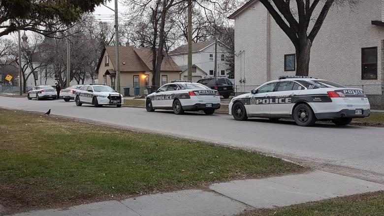 Police surround home in Winnipeg's North End after weapons call