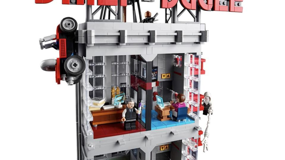 J. Jonah Jameson and Betty Brant's offices with them inside from LEGO's Daily Bugle set