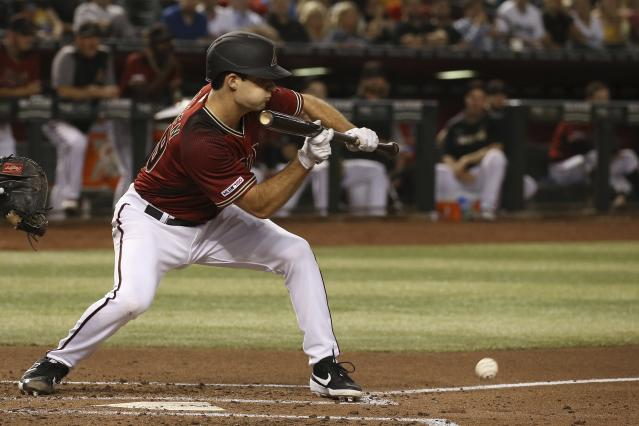 Arizona Diamondbacks' Zac Gallen drops down a sacrifice bunt against the Philadelphia Phillies during the third inning of a baseball game Wednesday, Aug. 7, 2019, in Phoenix. (AP Photo/Ross D. Franklin)