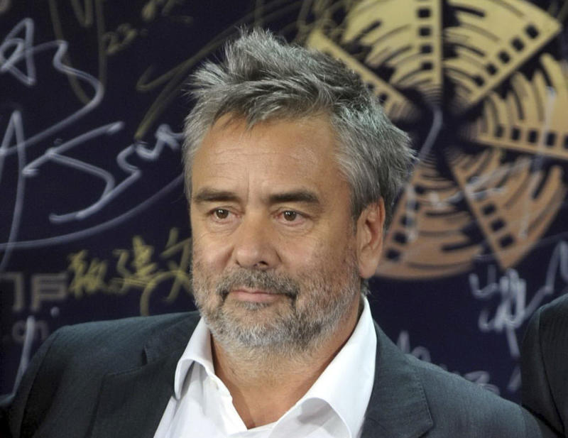 French director Luc Besson poses for photographers on the blue carpet before the award ceremony for the Beijing Film Festival in Beijing, Tuesday April 23, 2013. (AP Photo) CHINA OUT