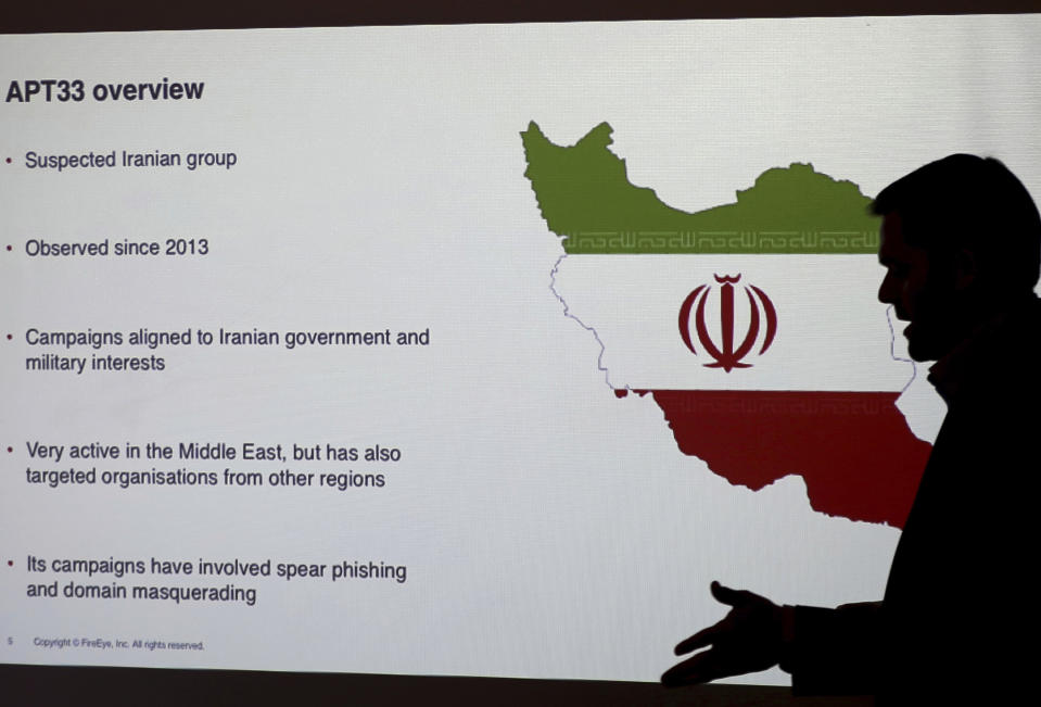 Stuart Davis, a director at one of FireEye's subsidiaries speaks to journalists about the techniques of Iranian hacking, Wednesday, Sept. 20, 2017, in Dubai, United Arab Emirates. A new report by FireEye, a cybersecurity firm, warned that a suspected group of hackers in Iran are targeting the aviation and petrochemical industries in Saudi Arabia, the U.S. and South Korea. (AP Photo/Kamran Jebreili)