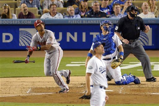 Arizona Diamondbacks' Chris Young, left, follows his two-run home run as Los Angeles Dodgers starting pitcher Clayton Kershaw, second from left, and catcher A.J. Ellis, second from right, watch along with home plate umpire Marty Foster during the fourth inning of their baseball game, Thursday, Aug. 30, 2012, in Los Angeles. (AP Photo/Mark J. Terrill)
