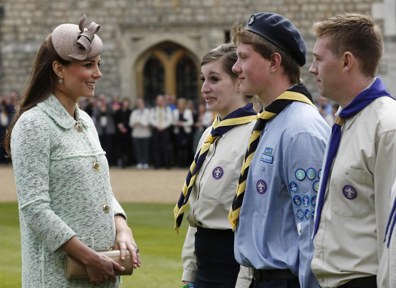 WINDSOR, UNITED KINGDOM - APRIL 21:  Catherine, Duchess of Cambridge talks with scouts as she attends the National Review of Queen's Scouts at Windsor Castle on April 21, 2013.  (Photo by Olivia Harris - WPA Pool/Getty Images)